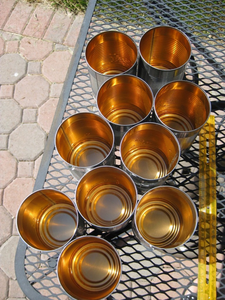Start by collecting 6 or more same-sized containers with straight sides. We are using 10 coffee cans in this example. You'll also need a ruler.