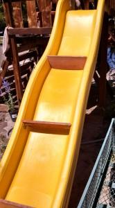 Slide with custom-built slats to hold soil.