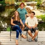 three people smiling on deck
