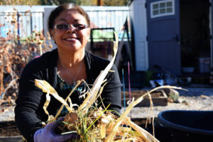 Woman holding garden debris.
