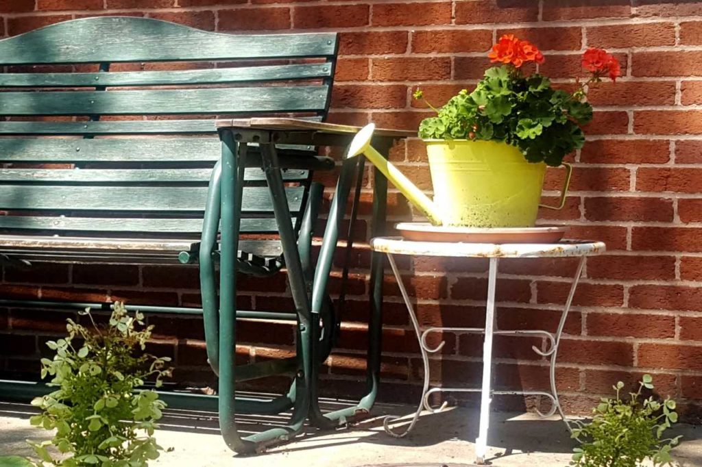 watering can and bench