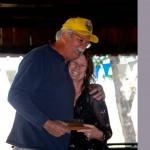 woman giving man award while hugging