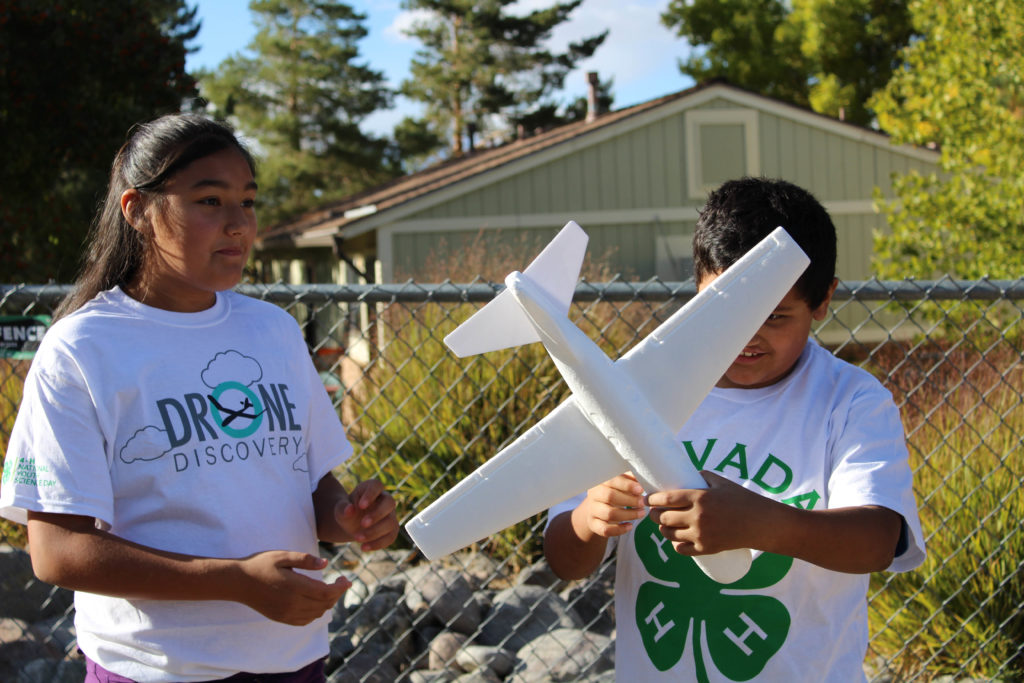 4-H students with foam airplane